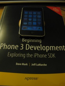 "iPod Touch on top of ""Beginning iPhone 3 Development"""